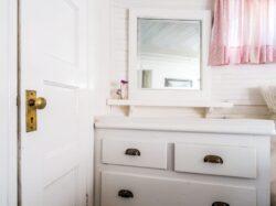 white wooden door near wooden dresser